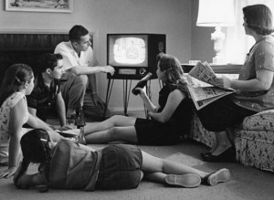 James S. Thomas and his family watch television in the living room of their home in Vienna, Virginia. Taken from the pamphlet: Television-Promise and Problem
